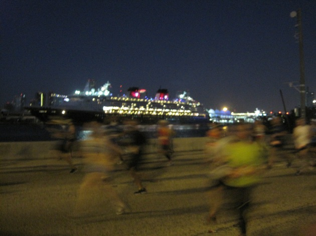 2. Enormous cruise ships keep watch over runners as they run over the MacArthur Causeway, a bridge that starts with the race's longest and highest climb.