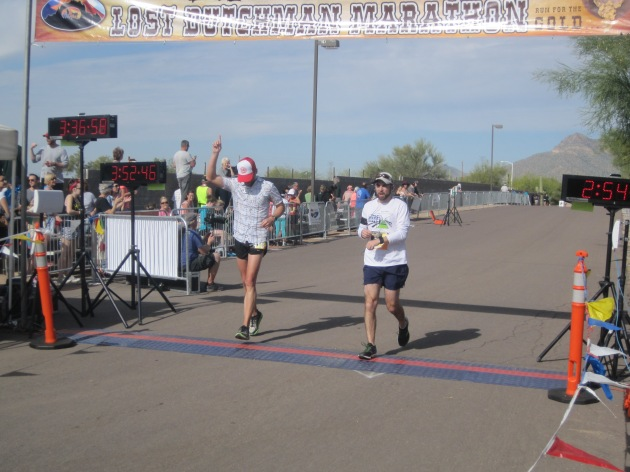 Finish - Nolan (right) crosses the timing mats with Carl (left)